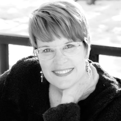 Smiling woman working for Sunshine Web Design Ames Des Moines